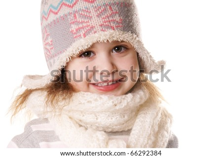 Portrait of smiling little girl in funny hat isolated on white background - stock photo