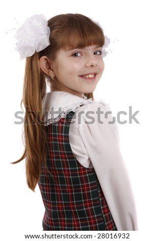 Portrait of smiling, little girl in school uniform. Young pupil is going to school. Isolated on white in studio. - stock photo