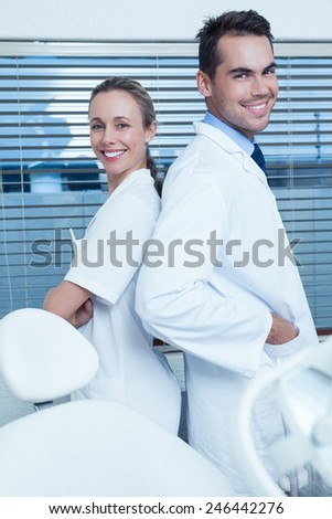 Portrait of smiling male and female dentists - stock photo
