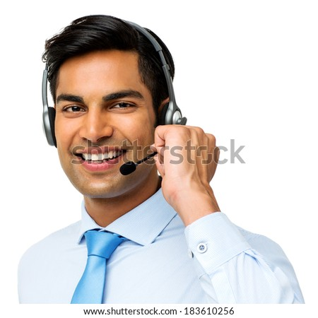 Portrait of smiling male call center representative wearing headset over white background. Horizontal shot. - stock photo