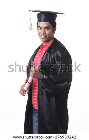 Portrait of smiling male graduate student against white background