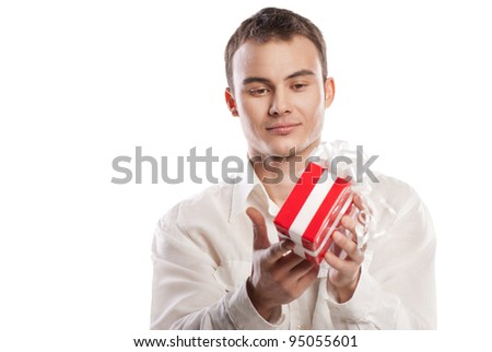 portrait of smiling man holding gift isolated on white background