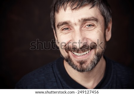 Portrait of smiling man in white - stock photo
