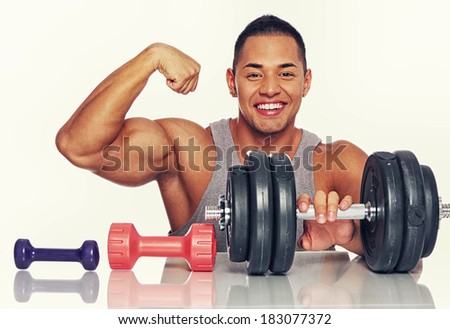 Portrait of smiling man with dumbbells - stock photo