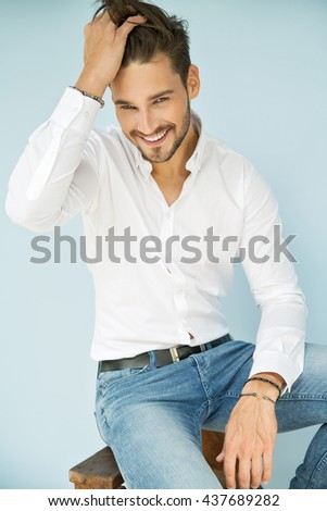 Portrait of smiling man with hand in his hair