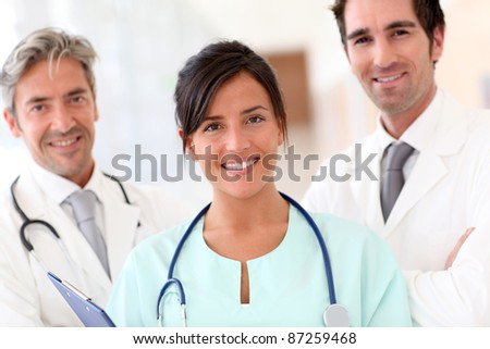 Portrait of smiling medical team - stock photo