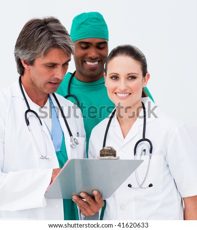 Portrait of smiling medical team taking notes