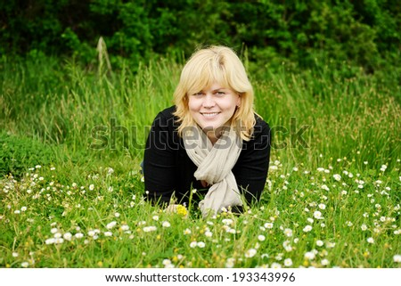portrait of  smiling middle aged woman  one the meadow - stock photo
