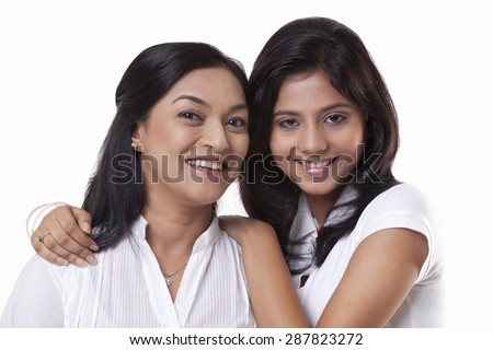 Portrait of smiling mother and daughter - stock photo