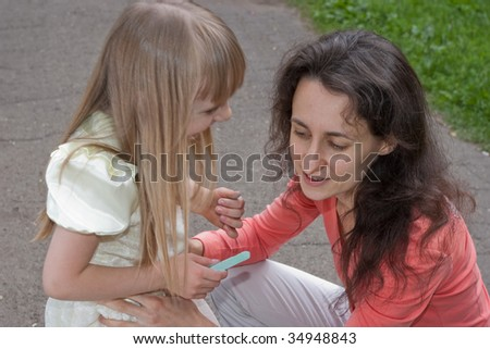 portrait of smiling mother and daughter outdoors