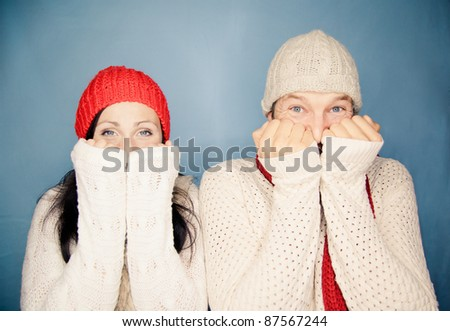 portrait of smiling mouth tapping couple looking in camera with opened eyes - stock photo