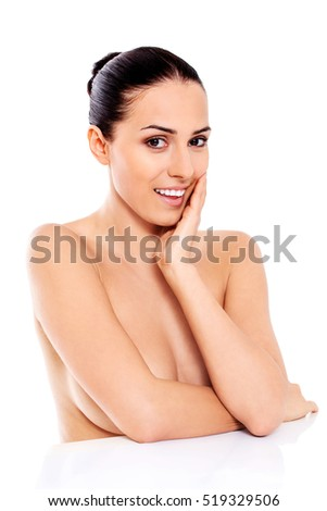 Portrait of smiling nude woman isolated on white background.