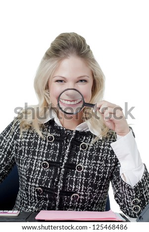 Portrait of smiling office girl holding magnifying glass against white background - stock photo