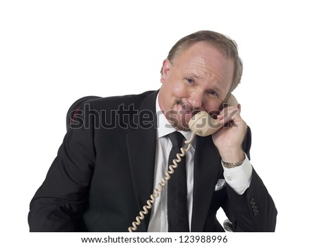 Portrait of smiling old business man talking to the phone against white background - stock photo