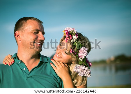 Portrait of  smiling people embracing tenderly and bonding - stock photo
