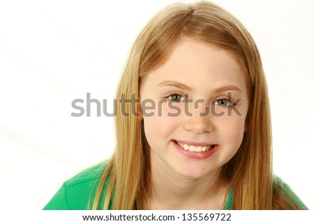 portrait of smiling preteen girl isolated on white