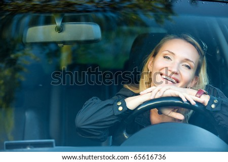 portrait of Smiling pretty woman in the new car  - outdoors - stock photo