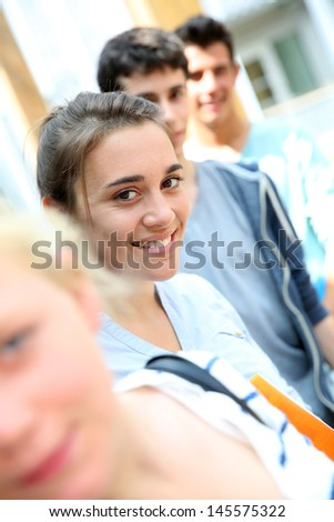 Portrait of smiling school girl amongst group