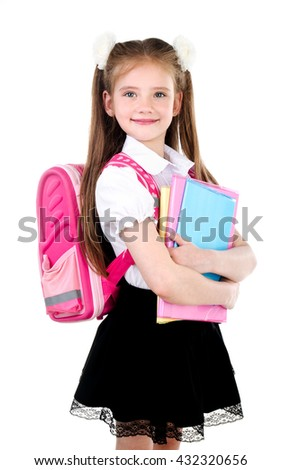Portrait of smiling schoolgirl in uniform with books isolated on a white background