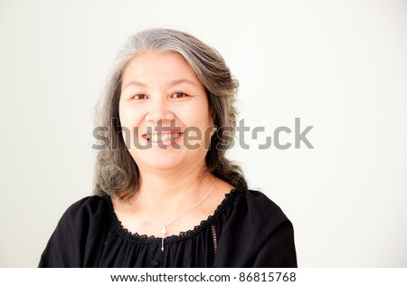 portrait of smiling senior asian woman - stock photo