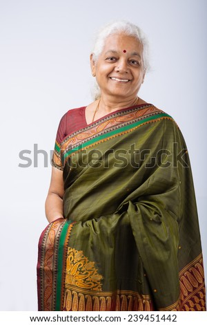 Portrait of smiling senior Indian woman in traditional costume - stock photo