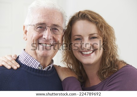 Portrait Of Smiling Senior Man With Adult Daughter