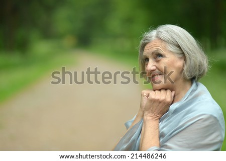 Portrait of smiling senior woman on nature