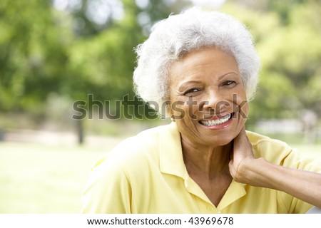 Portrait Of Smiling Senior Woman Outdoors - stock photo