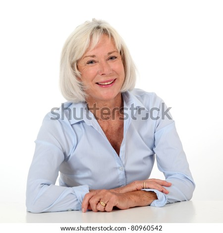Portrait of smiling senior woman with blue shirt