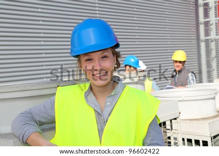Portrait of smiling student girl in professional training - stock photo