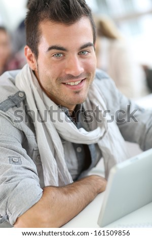 Portrait of smiling student guy in class