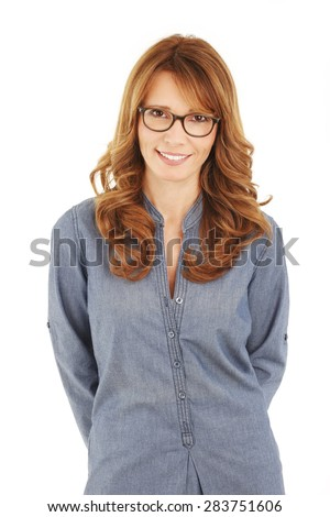 Portrait of smiling teacher looking at camera while standing against on white background.
