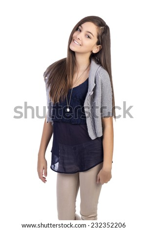Portrait of smiling teenage girl against white background - stock photo