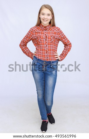 portrait of smiling teenage girl in shirt