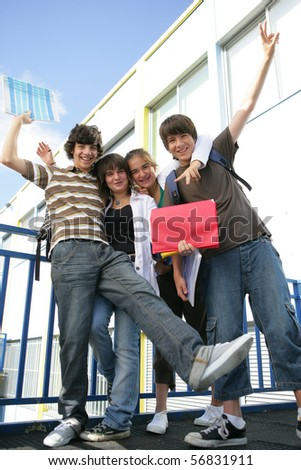 Portrait of smiling teenagers - stock photo