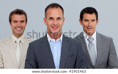 Portrait of smiling three businessmen with folded arms - stock photo