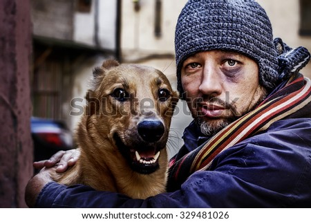 Portrait of smiling tramp and his dog. Image with toning and selective focus - stock photo