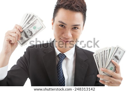 Portrait of smiling Vietnamese businessman with dollar bills in his hands