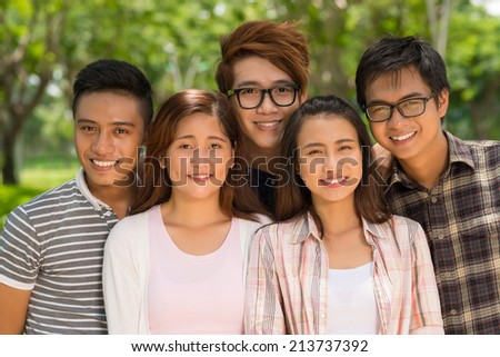 Portrait of smiling Vietnamese college students looking at the camera - stock photo
