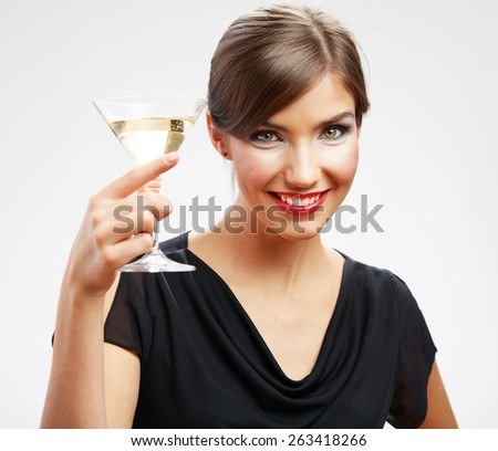 Portrait of smiling woman holding glass with drink. Girl celebrating event isolated portrait.