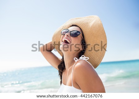 Portrait of smiling woman on the beach on a sunny day