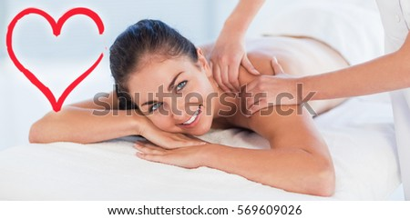portrait of smiling woman receiving massage