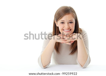 Portrait of smiling woman resting her chin on hand - stock photo