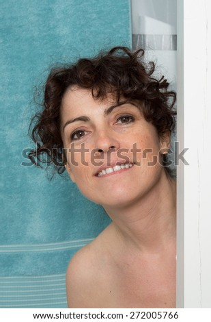Portrait of smiling woman taking shower - stock photo