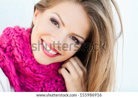 Portrait of smiling woman wearing woolen accessories - stock photo