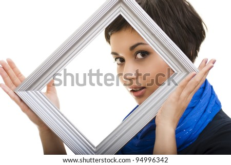 Portrait of smiling woman with frame - stock photo