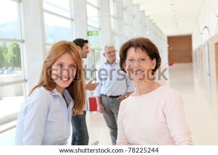 Portrait of smiling women in business training - stock photo