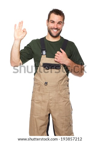 Portrait of smiling worker in brown uniform isolated on white background - stock photo