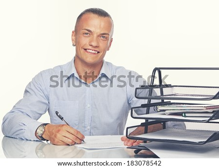 Portrait of smiling worker sitting in office