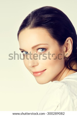 Portrait of smiling young attractive brunette businesswoman - stock photo